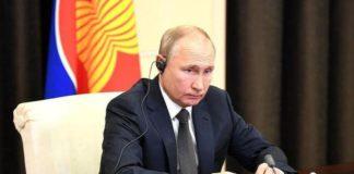 Putin signs law granting Russian